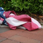 (Photo Credit: Stella Henderson/ THE SPECTATOR)  An American flag lies on the ground after being walked on in a protest that took place on campus April 17. Veteran Michelle Manhart was detained by VSU police after she tried to take the flag from protesters.