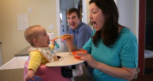 Sean Wylie and his wife Laura Wylie of Oak Park, Ill., feed their 7-month-old daughter Matilda on Saturday April 18, 2015. (Abel Uribe/Chicago Tribune/TNS) Photo Credit: MCTCampus
