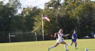 Forward/midfielder Madison Cutts dribbles the ball down the field to Blazer territory as a West Florida player runs in to intercept. The Blazers took a loss before the last home game of the season. (Photo Courtesy:  Lexis Lloyd)
