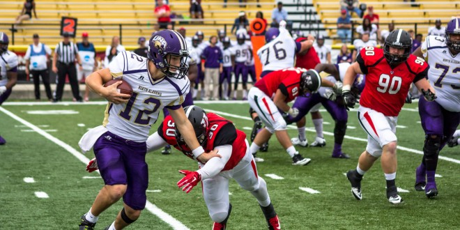 Sharmaine Washington tackles the Lions' quaterback, Luke Wingo, for a loss. Washington posted 7.5 tackles on the day. The Blazers defense totaled three sack against their conference rival. (Darian Harris/THE SPECTATOR)