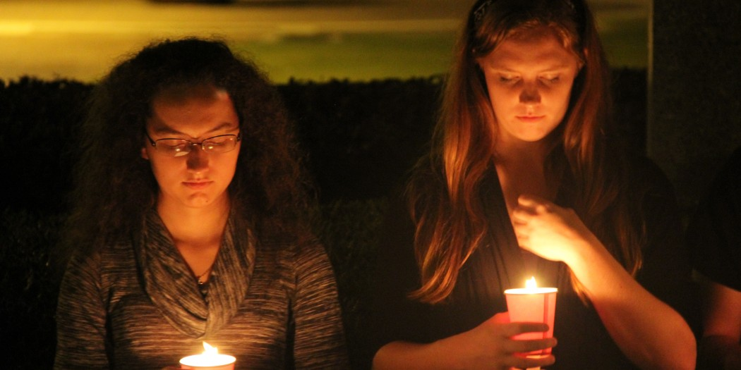 Students unite for the victims of both the Paris  attacks and Beruit Wednesday night on the front lawn. At least 40 students and faculty gathered for a moment of silence.  (Photos Courtesy: Stella Henderson/THE SPECTATOR)