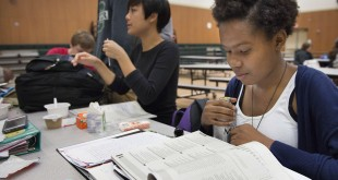Jade Thomas, 15, a junior at George Washington Carver School of Arts and Science, goes over study material before she takes the PSAT test on Wednesday, Oct. 14, 2015, in Sacramento. (Randy Pench/Sacramento Bee/TNS)