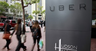 Foot traffic streams past Uber offices on Market Street in San Francisco. (Karl Mondon/Bay Area News Group/TNS)