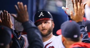 The Atlanta Braves' A.J. Pierzynski gets high-fives in the dugout after hitting a solo home run against the Washington Nationals during the fourth inning on Tuesday, Sept. 29, 2015, at Turner Field in Atlanta. (Curtis Compton/Atlanta Journal-Constitution/TNS)