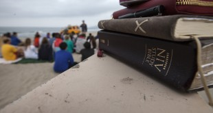 Bibles rest on a beach wall during Pepperdine's Wednesday morning Surf Chapel on Zuma Beach March 11, 2015 in Malibu, Calif. (Brian van der Brug/Los Angeles Times/TNS)