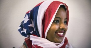 "St. Cloud State student Barwaaqo Dirir, 21, decided to wear an American flag hijab for the first time while attending a talk by Jaylani Hussein, executive director of the Minnesota chapter of the Council of American Islamic Relations of Minnesota (CAIR-MN) on Islamophobia in Minnesota at St. Cloud State University on Feb. 9, 2016 in St. Cloud, Minn. ""I woke up this morning and people were looking at me differently, said Dirir. ""This is my home. We're not going anywhere."" (Leila Navidi/MInneapolis Star Tribune/TNS)"