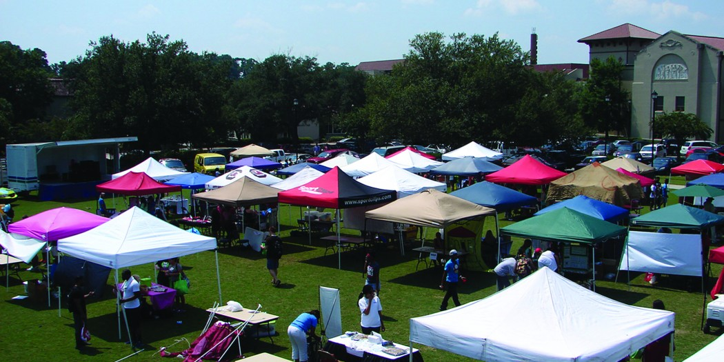 Students walk around a maze of tents at The Happening 2016 begins today at 1 p.m. (Spectator File Photo)