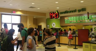 Students and staff wait in line at Moe's during a lunch-time rush. Which Wich  will open where Moe's line forms now. (..../)