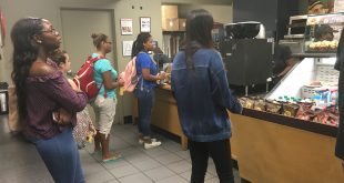 Customers walk in line at Einstein's for  food. Prices have increased, but students and employees are pleased with Aramark changes. (Photo Credit: Jada Dukes/THE SPECTATOR)