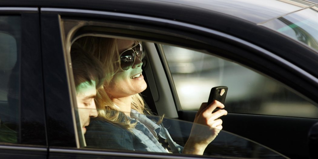 According to a State Farm survey, many drivers look forward to texting and taking care of other business in their semiautonomous cars. (Mel Melcon/Los Angeles Times/TNS)