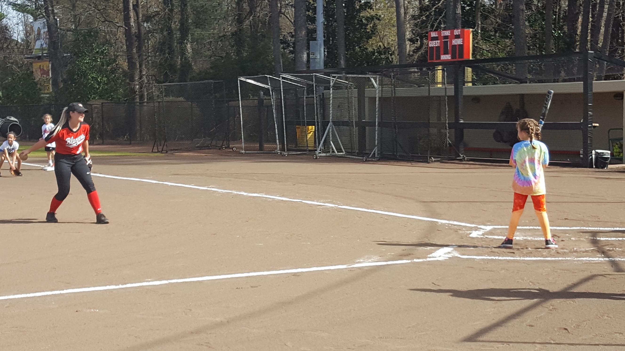 softball pitching to kid